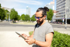 Man traveling with backpack and tablet pc in city Royalty Free Stock Photography
