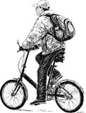 Man traveling on a bicycle Stock Photo