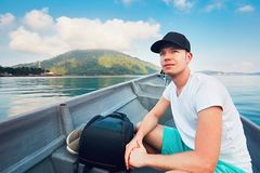 Man traveling by boat to tropical island Royalty Free Stock Photo