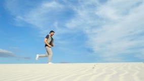 Man traveling in desert stock video