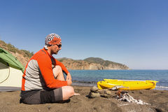 A man traveling by kayak along the coast. Royalty Free Stock Photography