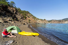 A man traveling by kayak along the coast. Royalty Free Stock Images