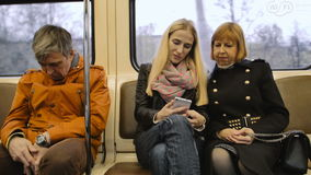 Man traveling by metro and sleeps. Man traveling by subway and sleeps while two womans talk stock video