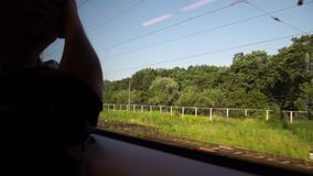 Man traveling by train, looking at the window. Silhouette man traveling by train, looking at the window stock video