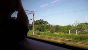 Man traveling by train, looking at the window stock video