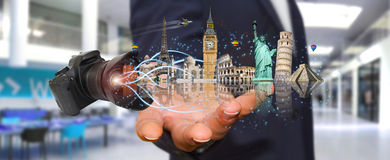 Man traveling the world with his digital camera Stock Photo