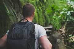 Man traveller. Man traveller with backpack in the forest Stock Photo