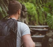 Man traveller. Man traveller with backpack in the forest Stock Photos