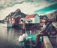 Man traveller in Reine village, Norway Royalty Free Stock Photography