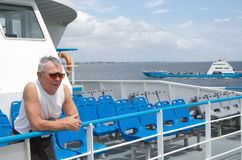 Man travelling on ferry. Senior man travelling on ferry, going on holidays Royalty Free Stock Images