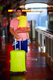 Man travelling with kid on hands. Young men travelling with kid on hands Royalty Free Stock Image