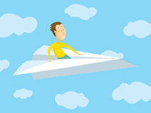 Man travelling on paper airplane Stock Photos