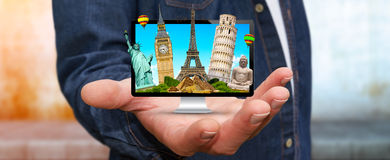 Man travelling the world with his computer Stock Images