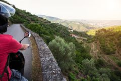 Man travels on a motorcycle stopped at a view point at the Douro Valley. Royalty Free Stock Image