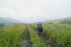 Man travels in the rain Royalty Free Stock Photos