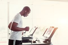 Man on treadmill in fitness club, healthy lifestyle Stock Images