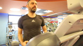 Man on a treadmill at the gym stock video
