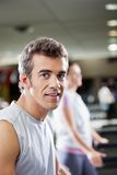Man On Treadmill In Health Club Royalty Free Stock Photos