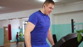 A man on a treadmill stock footage