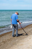 Man Treasure hunting on the beach Royalty Free Stock Images