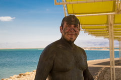Man treated mud, Dead Sea Stock Photos