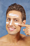 Man treating his face with skin Stock Photo