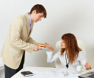 Man treats woman colleague hamburger Stock Photo