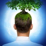 Man with tree. Man with green tree growing on his head Royalty Free Stock Photos