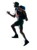 Man trekker trekking running happy  silhouette. One caucasian man trekker trekking running happy  in silhouette isolated on white background Royalty Free Stock Photos