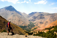 Man trekking in atlas mountains, morocco. Man in atlas mountain scene stock photo