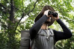 Man Trekking in a forest Royalty Free Stock Photos