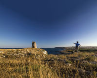 Man trekking mountain near the sea otranto Royalty Free Stock Image