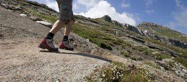 Man trekking in mountains Stock Photos