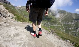 Man trekking in mountains Stock Photo
