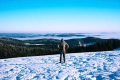 Man trekking in mountains in winter. stock photo