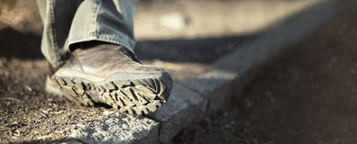 Man trekking shoes. Website banner - sole of male trekking / hiking shoes stock images