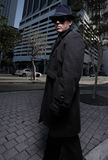 Man in a trench coat. Eerie man in a trench coat in the city Royalty Free Stock Photography