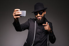 Man in trendy cloth taking selfie photo Royalty Free Stock Images