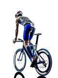 Man triathlon iron man athlete cyclist bicycling. Man triathlon iron man athlete biker cyclist bicycling biking in silhouette on white background Royalty Free Stock Photos