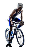 Man triathlon iron man athlete cyclist bicycling Stock Photography