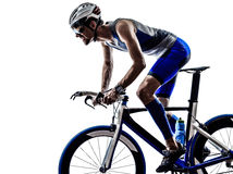Man triathlon iron man athlete cyclist bicycling. Man triathlon iron man athlete biker cyclist bicycling biking in silhouette on white background Royalty Free Stock Photo