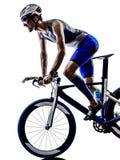 Man triathlon iron man athlete cyclist bicycling Stock Photo