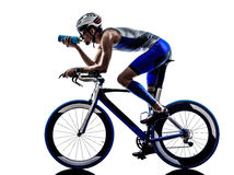 Man triathlon iron man athlete cyclist bicycling drinking Royalty Free Stock Photo