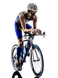 Man triathlon iron man athlete cyclists bicycling. Man triathlon iron man athlete bikers cyclists bicycling biking  in silhouettes on white background Royalty Free Stock Images