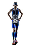 Man triathlon iron man athlete runners running. In silhouettes on white background Royalty Free Stock Photo