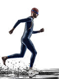 Man triathlon iron man athlete swimmers running. Man triathlon iron man athlete swimmers swimmers running in silhouette on white background Stock Images