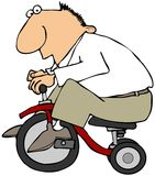 Man On A Tricycle Stock Photo