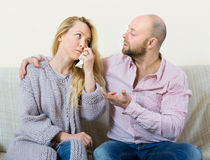 Man tries reconcile with woman Royalty Free Stock Image