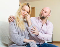 Man tries reconcile with woman Stock Image