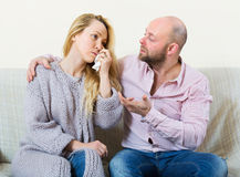 Man tries reconcile with woman Stock Photos